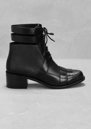 Crafted from grainy leather, these low-heel ankle boots feature contrasting smooth leather straps across the toe and around the ankle.