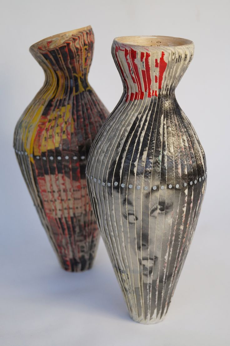 Tracie Murchison vessels made from wooden veneers, vintage magazines and steel pins...