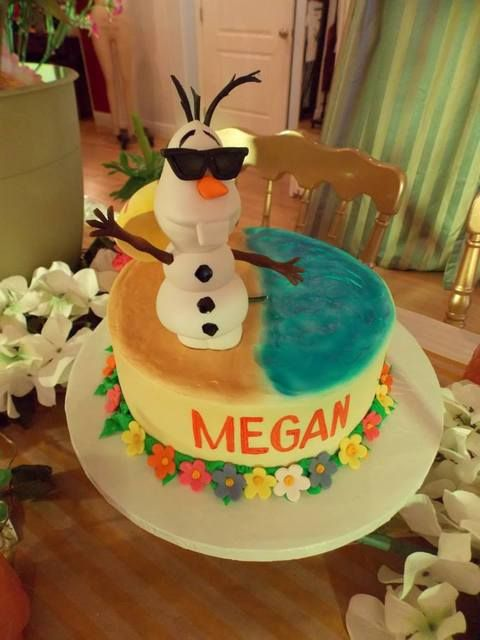 Cool Olaf cake at a Summertime Frozen birthday party!