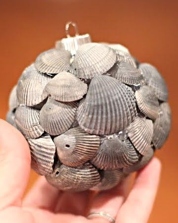 hot glue shells on a Styrofoam or plastic ball ornament. Overlap the thin ends of the shells