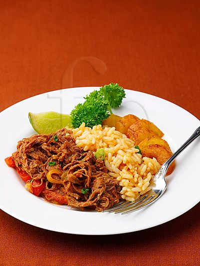 """One of my favorite Cuban dishes """"Ropa Vieja"""" with Platano Maduros... yum!"""