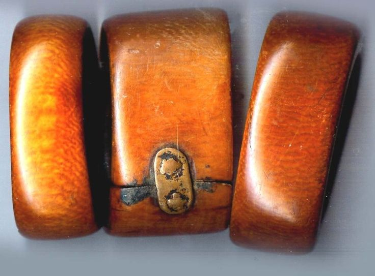 Africa | Three heavily patina'd or dyed African ivory bracelets.  Possibly originated in Cameroon. |  © Linda Pastorino