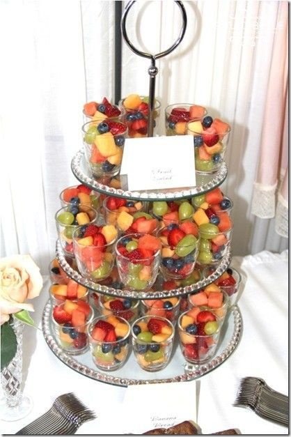 Ready made fruit cup for get togethers. Plastic cups filled with cubed fruit and placed on tiered stand. For added decor, can add printed cupcake liners to cups and then add fruit. {www.artisansbloom.com}