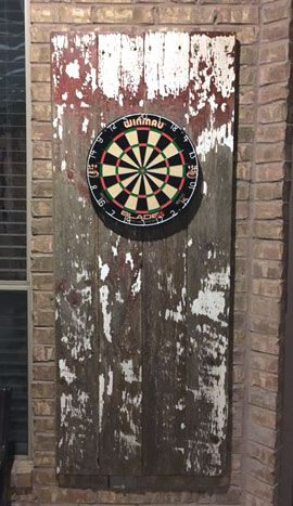 Rough and ready piece of wood used as a dartboard surround