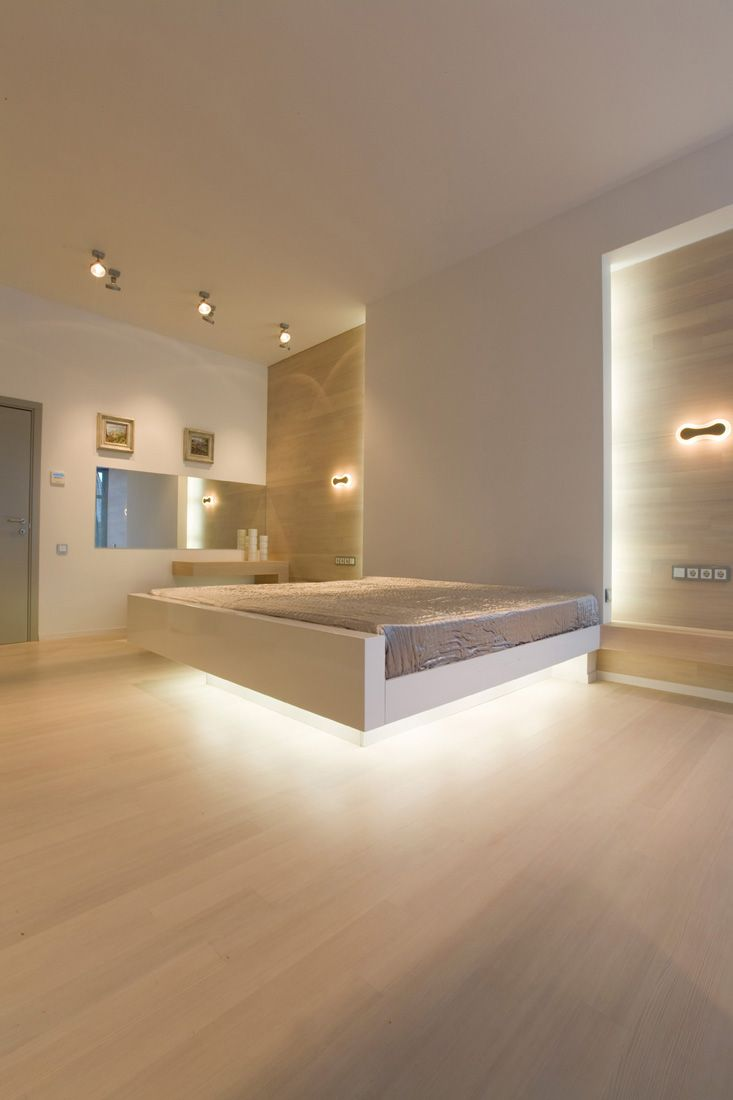 Floating bed with integrated lighting in House 02 by za bor Architects.