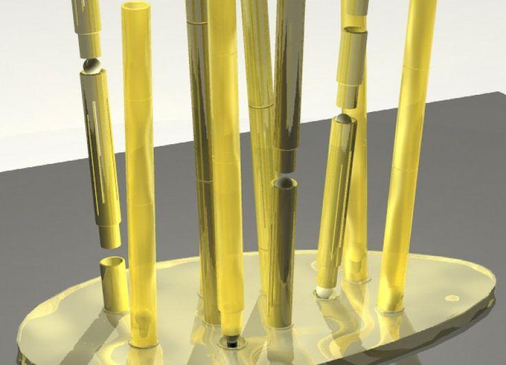 Lampada Kanneto: leggera perchè composta da una base ovaloide in alluminio riciclato, martellato e dorato; trasformabile perchè formata da tubi in vetro soffiato traslucido, o opaco da disporre nella base variando la posizione, la lunghezza, e la quantità di luce;  ecologica perchè composta, quasi interamente, di materiali riciclati. Dimensioni: base cm 100 x cm 52.10 altezza totale cm.75.20 altezza singole parti: base cm 5.00 tubi cm 30.50