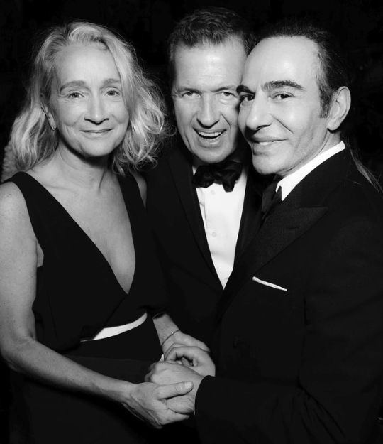 Lucinda Chambers (Fashion Director of British Vogue at that time), Mario Testino & John Galliano at the British Fashion Awards, December 2014. Photographed by Darren Gerrish.