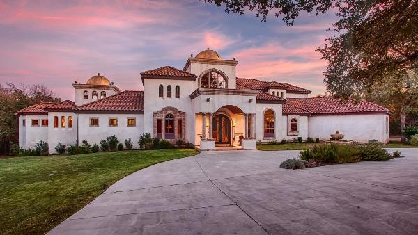 New Braunfels Real Estate - Featured Property - 351 Mariposa Loop New Braunfels, TX 78132    Nestled on two wooded acres in a private, gated river front community lies this exquisite residence with Tuscan and Spanish influences