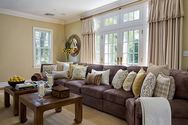 purple couch and golden decor