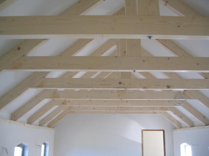 Swissline design products exposed roof trusses and roof for Vaulted ceiling with exposed trusses