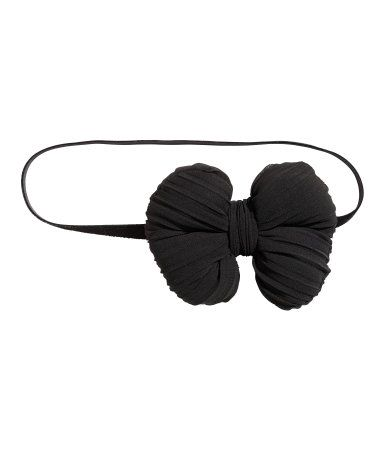 Black. BABY EXCLUSIVE. Elastic hairband with a decorative chiffon bow.