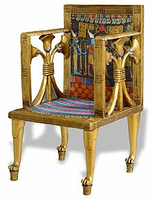 This picture is a good representation of how chairs were decorated for those with status.  The legs are shaped like the paws of lion and raised off of the floor which is typical during this time period.  The height of the chair suggests that it was used for someone of importance.  The chair also appears to be inlaid with precious metals and stones to give it the coloring it has, which was also only reserved for those with status.