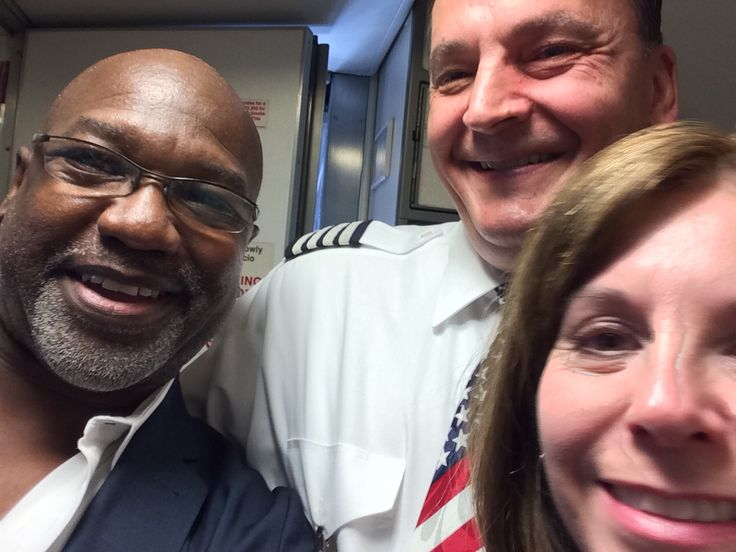 At John Wayne Airport (SNA) taking a Selfie with my Southwest Airlines pilot and flight attendant.