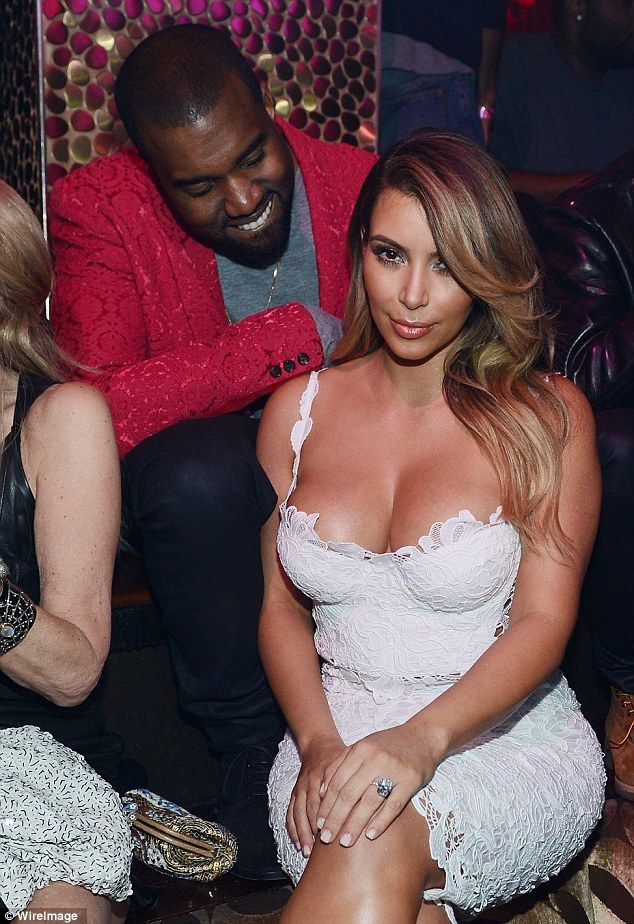The look of love: Kanye West looks down at Kim Kardashian with adoration at her birthday party