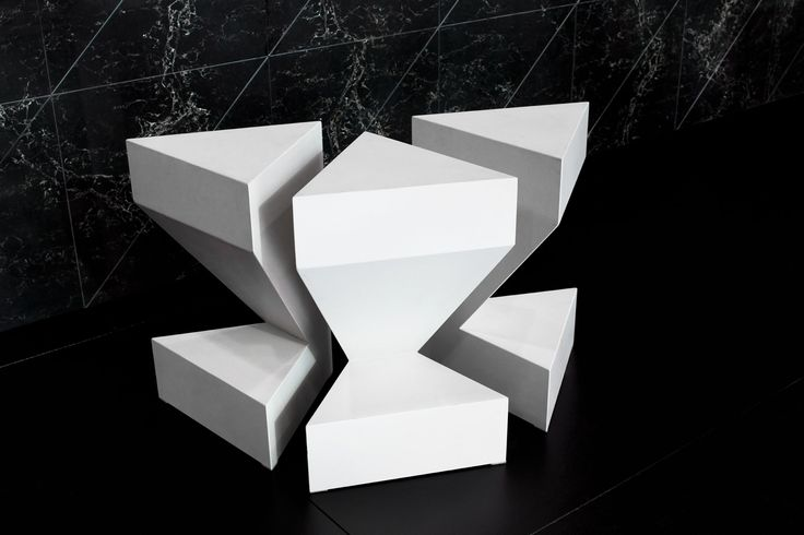 Chairs designed by Tom Dixon. http://www.elementsbycaesarstone.com/page_ice.html