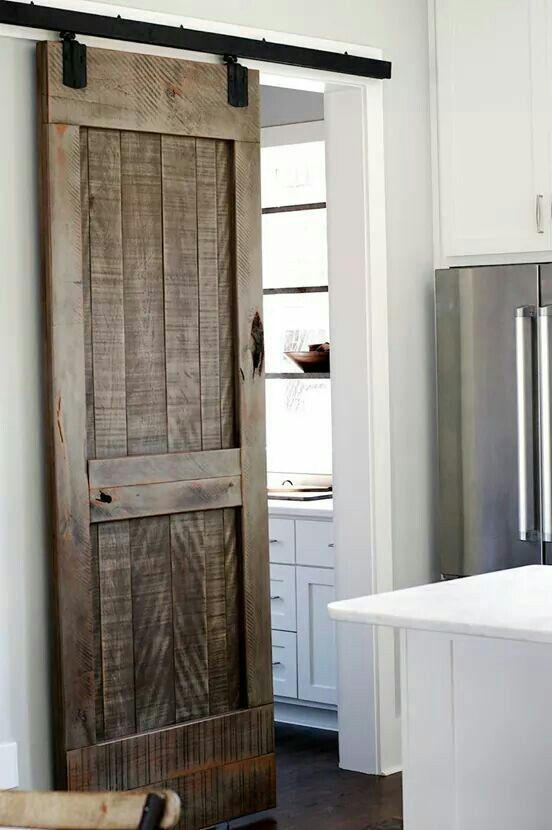 Love the barn door, floors, stainless steel appliance, and white cabinets.  Not wild about the white counter tops.....too much white, needs something to break it up