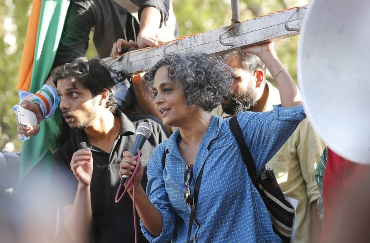 epa05212909 Human rights campaigner Arundhati Roy(R) adresses as Jawaharlal Nehru University (JNU) students participate in a protest march in New Delhi, India, 15 March 2016. The protesters were demanding the immediate release of Jawaharlal Nehru University (JNU) students. Kanhaiya Kumar, the students union president of Delhi's Jawaharlal Nehru University (JNU) was held on sedition charges but got released earlier this month. A former Delhi University professor was also arrested on 16…