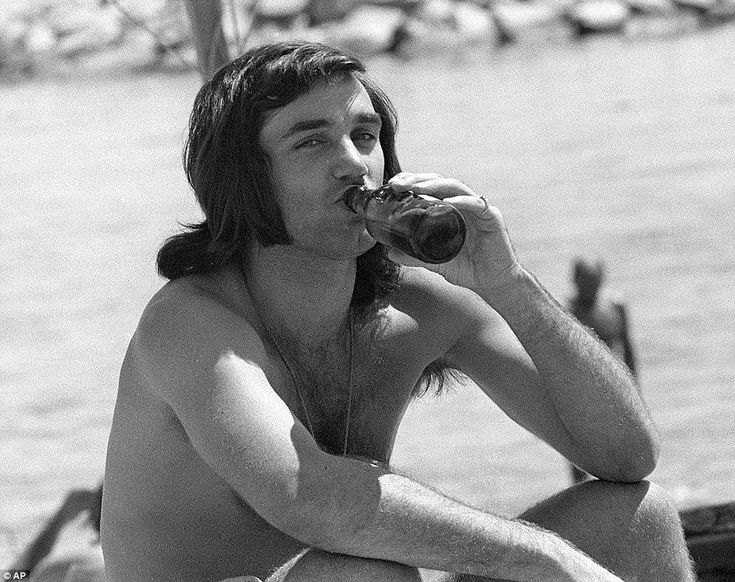 Life's a beach: Best enjoys a beer on the sands in Marbella, Spain following the conclusion of the 1971-1972 season