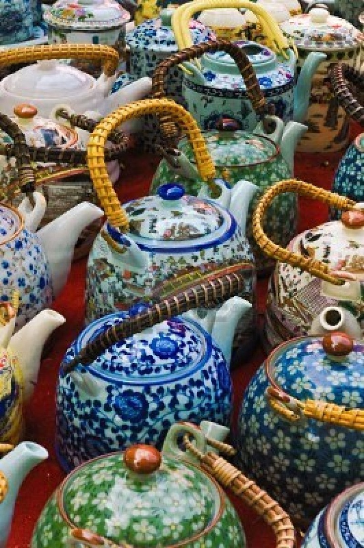 Blue, green, yellow and orange ceramic Chinese teapots