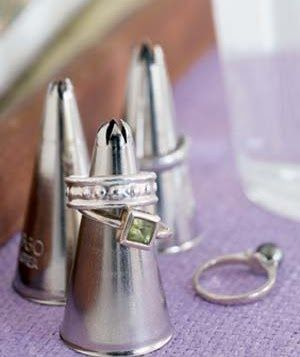 Icing tip as ring display - so sweeeeeet!  jewelry display  Gift Shop Magazine  | http://awesomewomensjewelry.blogspot.com