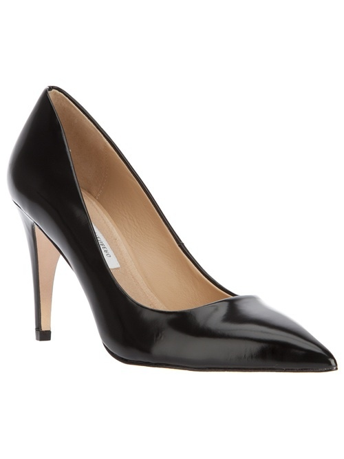 Black leather pump from Diane von Furstenburg featuring a classic curved top line, a stiletto heel and a pointed toe.