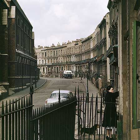 A view west along the now-demolished curved terrace in Clarendon Street, Paddington, with St Mary Magdalene's Church to left. These terraced houses backed on to the Paddington Branch of the Grand Union Canal - 1955 - 1965