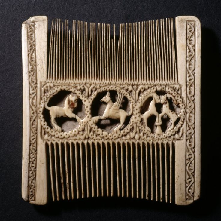 Comb; ivory; double-ended; the central fillet decorated with three animals each within a pierced circular frame, the spandrels with leaves; the borders with a band of leaf scroll decoration; Germany, late 12th century  British Museum Registration number: 1916,0403.1