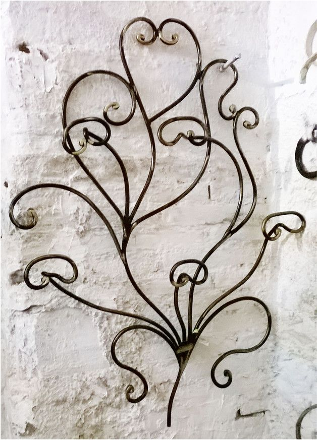 Oltre 25 fantastiche idee su sculture di filo su pinterest - Vi si confezionano tappeti da appendere al muro ...
