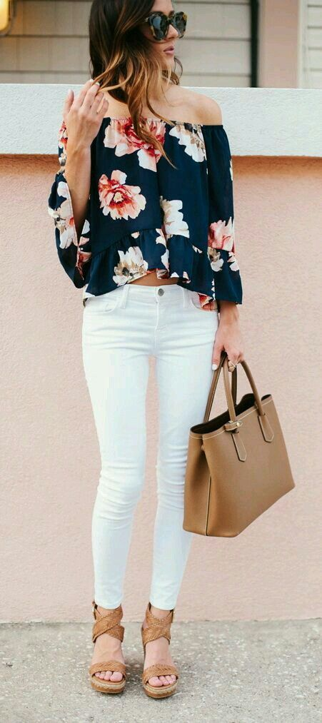 White jeans, flowy flowery top and tan accessories.