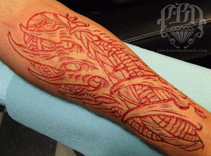 New scarification by ryan ouellette at precision body arts for New hampshire tattoo
