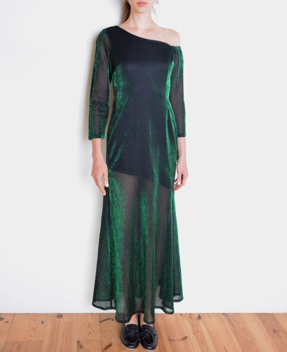 Cool vintage dress - made of two layers of fabric - asymmetric mini base, covered with long sheer layer of black-green metallic fabric. Maxi