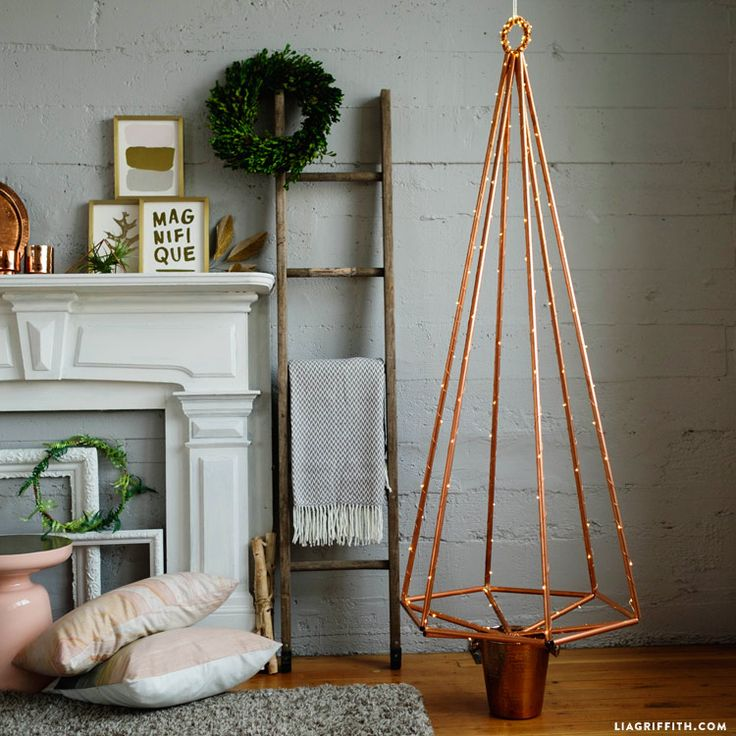 Want a Christmas tree without the pine needle mess? Learn how to make a gorgeous copper Christmas tree with copper pipe that you can use for years to come