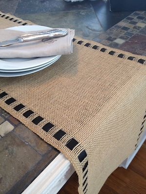 Burlap table runner with ribbon.