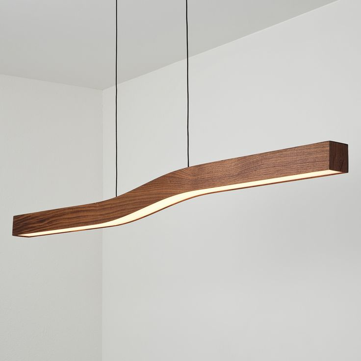 Like a river of wood and light, Camur snakes through the air with a breeze sophisticated air. http://www.ylighting.com/blog/new-exclusive-modern-luminariesfrom-cerno/ #YinTheWild