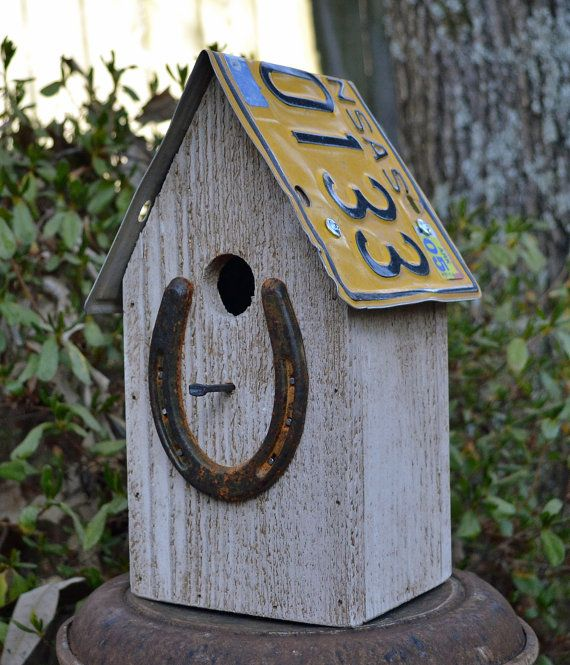 This rustic house is made from cedar wood with a recycled license plate roof that removes for easy cleanout. Has rusty horseshoe on the front with