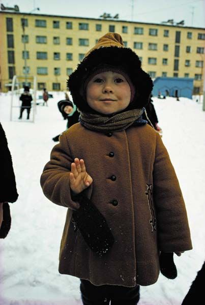 In Soviet Murmansk, near the Arctic Circle, a child gives her age in response to the photographers question. - Dean Conger