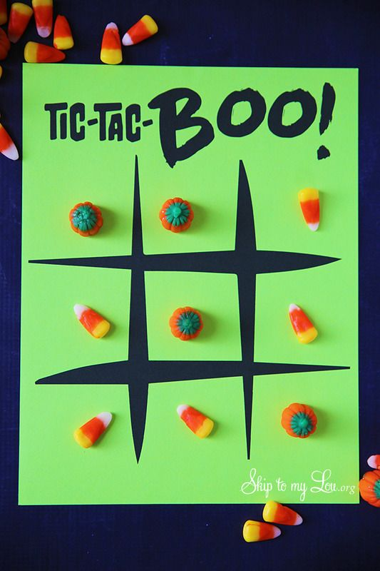 Free printable Halloween tic tac toe board for parties: Candy corn makes the perfect reusable game pieces!