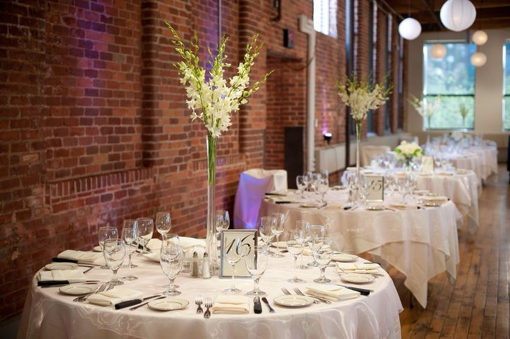 Blush and bright wedding  simple tall orchid centerpieces