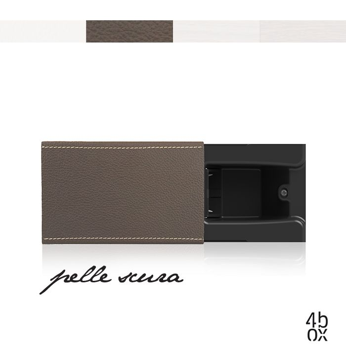 Pelle Scura The plug is there, but you can't see it. Hide by 4box revolutionises the power socket concept. The plug disappears inside the wall, behind the sliding cover, and the wall always stays free and tidy. Pelle Chiara, Pelle Scura, Legno Chiaro and Legno Scuro: four new styles to customize Hide as you like. #4box #hide #materials2014 #archiproducts #socket #electricrevolution #electricrev #style #home
