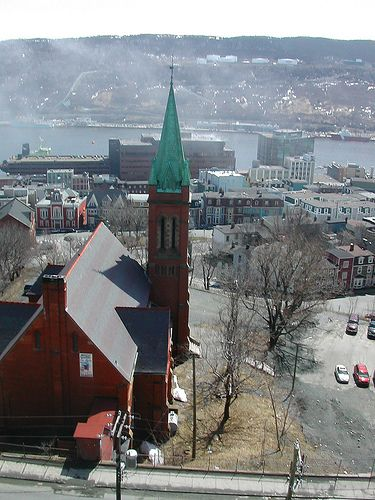 """St Andrew's Presbyterian Church, St John's Newfoundland, also known as """"the Kirk"""" with harbour in the background, Canada"""