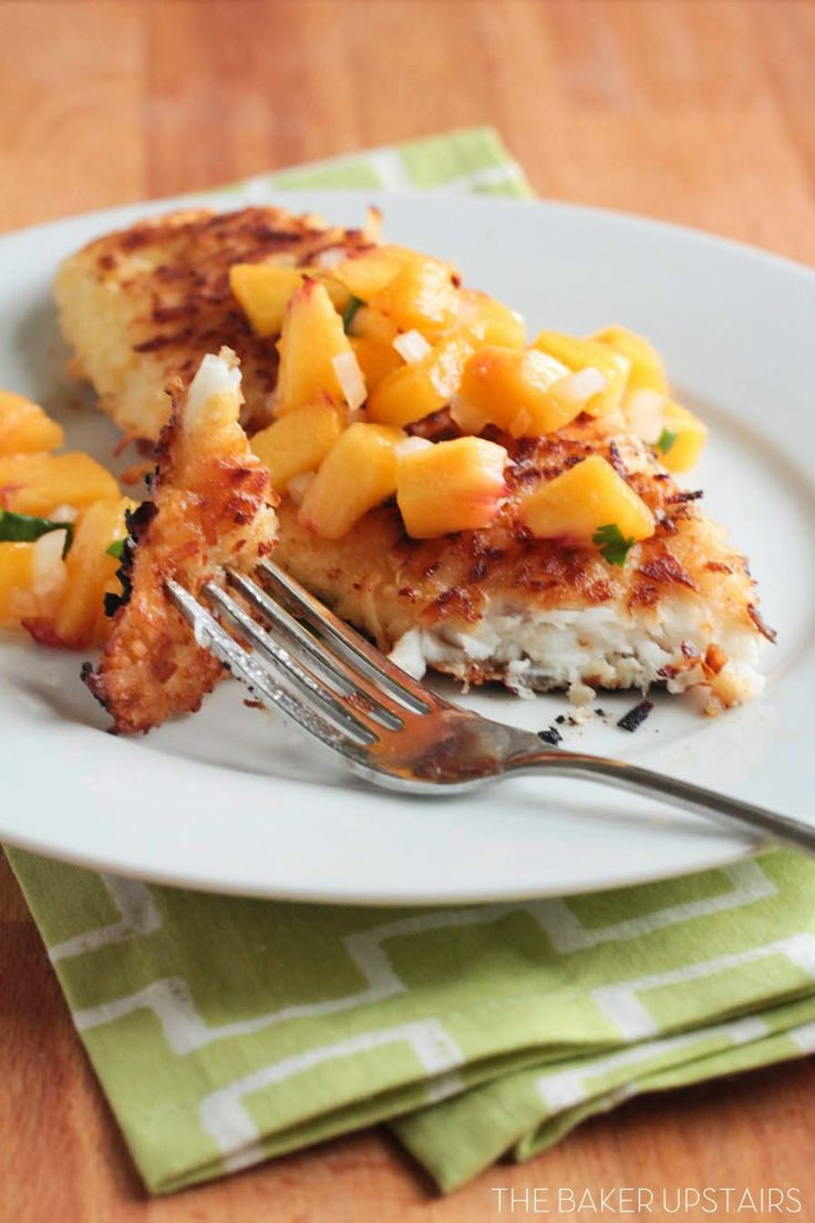 Coconut-crusted tilapia with fresh peach salsa - a quick and easy dinner that's super delicious! www.thebakerupstairs.com