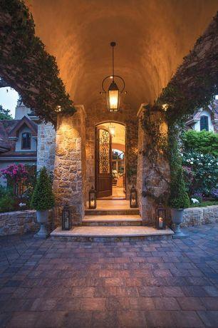 Mediterranean Front Door with exterior stone floors, Raised beds, Trellis