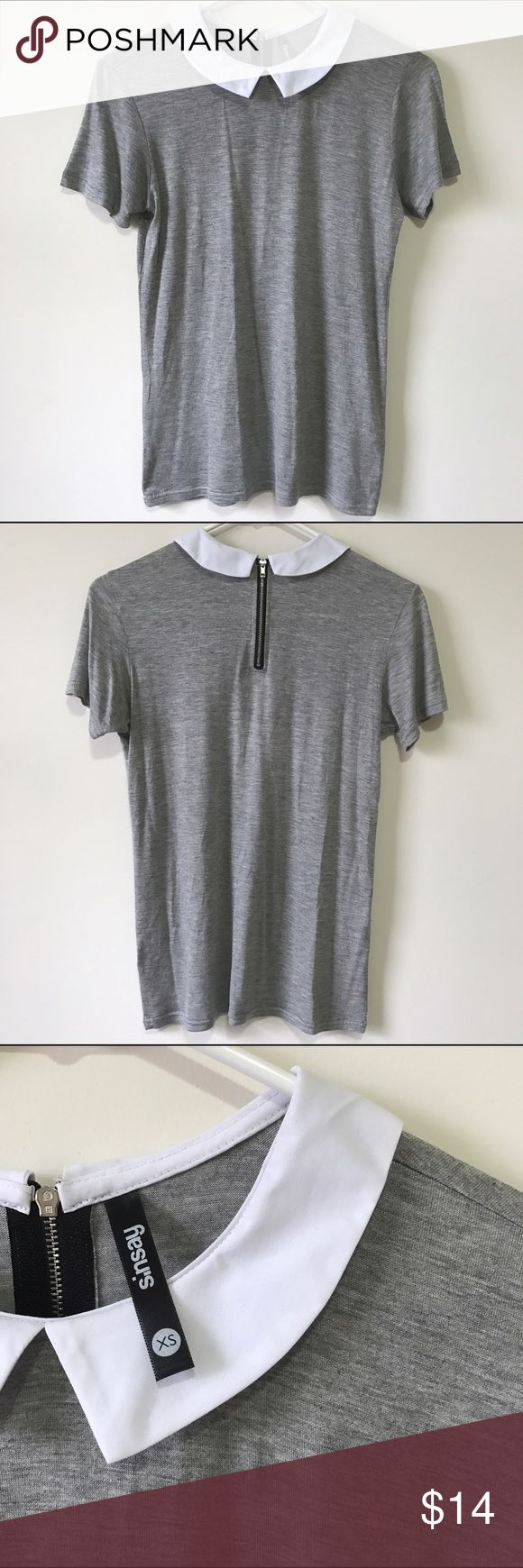 Gray collared tee Gray collared tee. Very soft and stretchy fabric. Zipper on back. Only wore once. Very great condition. Sinsay Tops Tees - Short Sleeve