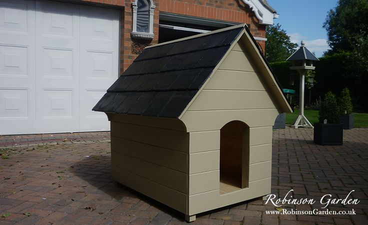 A beautiful and bespoke wooden dog kennel / dog house with a slate roof. Hand crafted and hand painted in Lincolnshire, England by Robinson Garden. Visit our website for more details.