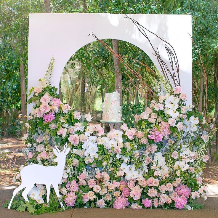 Beautiful creation complemented by our custom backdrop & deer  #Repost @maryronisevents  We had the pleasure of creating an enchanted garden for little Krystelle's 5th bday at bicentennial park over the weekend.   Absolutely in love with the way it turned out.   Styling & design @maryronisevents   Pic @arianaphotographystudio   Flowers @crazyaboutflowers   Cake @sweetbloomcakes   Backdrop and deer @edgehousedesign @jossignsbydesign   Props, tables & chairs @tiny_tots_toy_hire