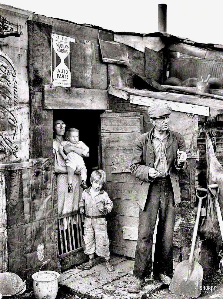"""January 1939. """"Herrin, Illinois. Family on relief living in shanty at city dump."""" (Photo by Arthur Rothstein for the Resettlement Administration.)"""