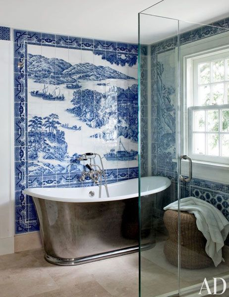 A bath in Shelter Island, New York, sports a mural by Chelsea Arts Tile + Stone; the tub is by Waterworks, with fittings by Lefroy Brooks.  Pin it.