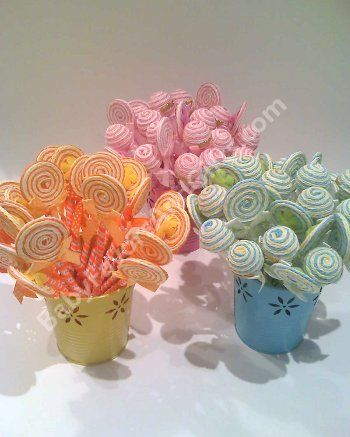 baby shower decorations  - possibly cake balls or lolli pops in containers