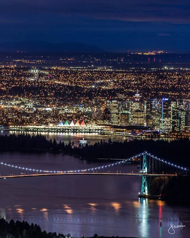 Vancouver BC - Beautiful rainbow coloured sails illuminated at Canada Place, as seen from Cypress Lookout DRS