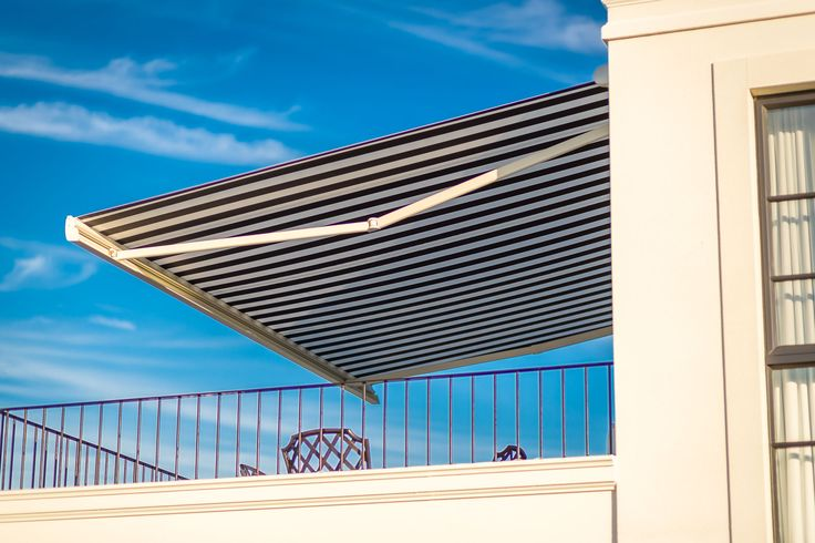 Create a luxury modern home with outdoor retractable awnings.